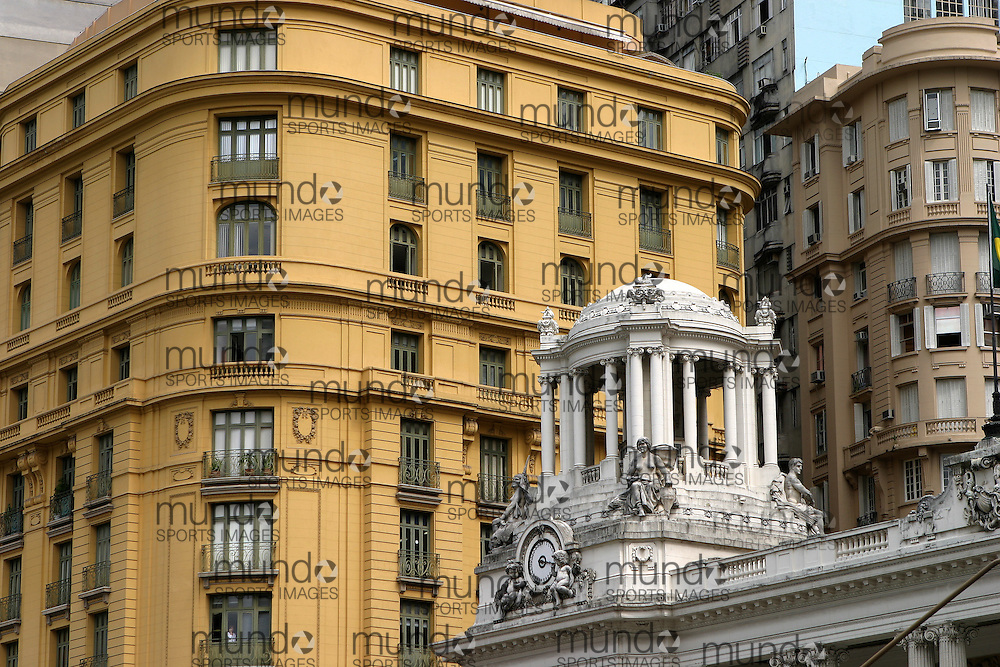 A view past a tower on the Brazilian Academy of Letters to a building in the square in front of the Theatro Municipal (Municipal Theatre) in Rio de Janeiro.