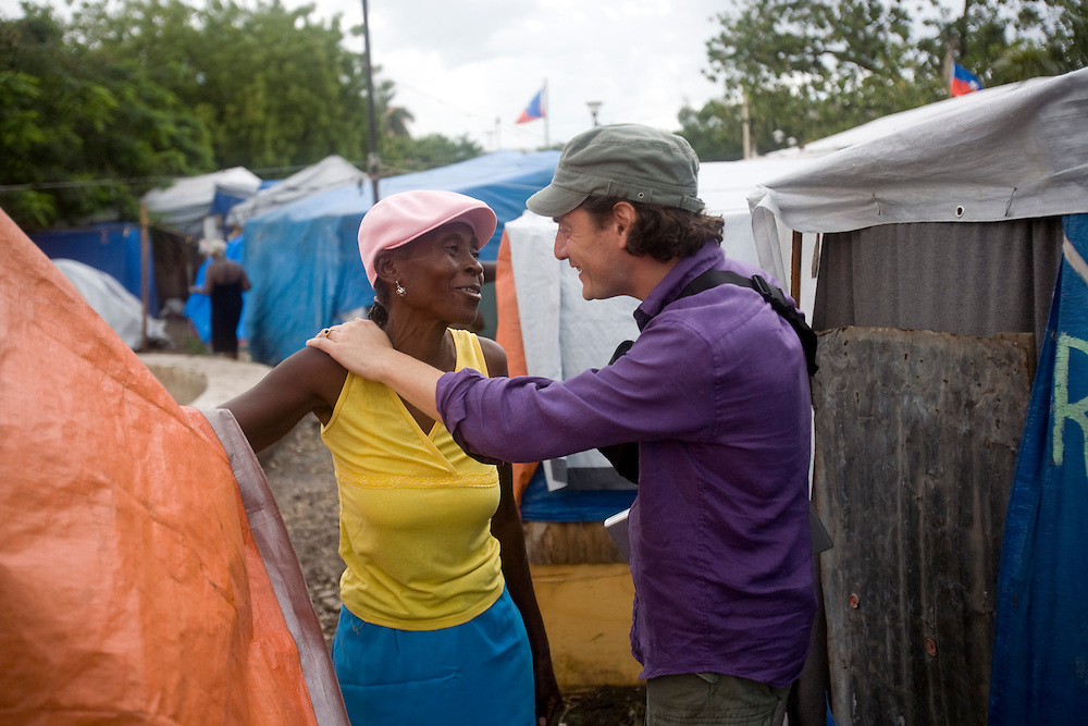 David Koubbi talks to a woman living in a camp of people displaced by the earthquake. Koubbi, a French lawyer, is visiting Haiti to advocate to the Haitian government for passports for 56 children. The children were in the adoption process before the earthquake and though the adoptions have all been finalized, the children need passports before they can join their adopted families in France.