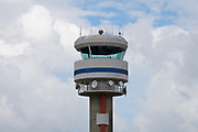 Air traffic control tower in the clouds with microwave and radio antennas - Cairns Airport, Queensland, Australia