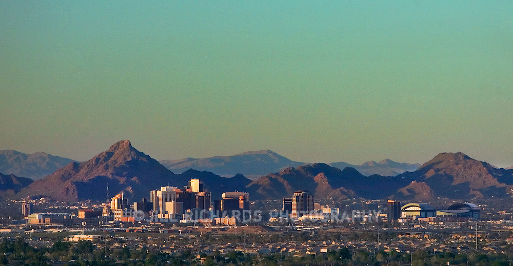 Downtown Phoenix city skyline at dusk, shot from South Mountain Park and Preserve in Phoenix, Arizona.
