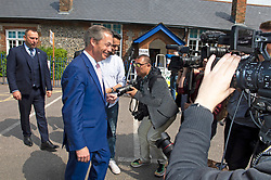 © Licensed to London News Pictures. 23/05/2019.<br /> Downe,UK. Mr Farage leaving after casting his vote. Brexit Party leader Nigel Farage voting in the European elections at Cudham C of E primary school, Downe, Kent. Photo credit: Grant Falvey/LNP