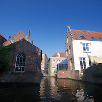 "Brugge - a medieval harbor city that kept it's canals long after the harbor silted up, earning the moniker ""Venice of the North"""