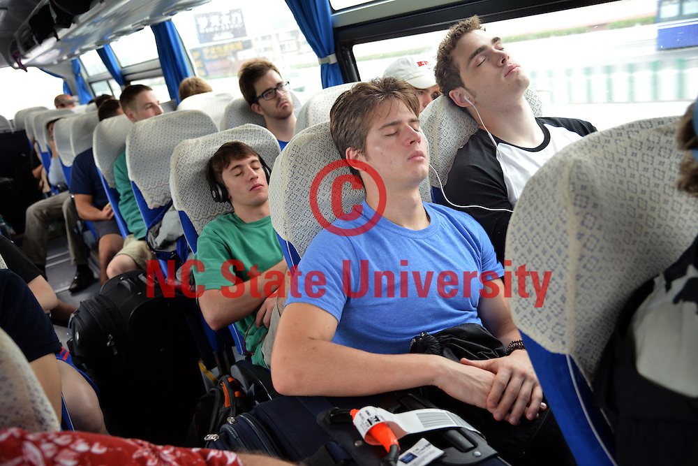 Poole College of Management students nap as the group leaves early morning for the Shanghai train station.