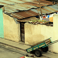 "Central America, Guatemala, Antigua. An empty cart has seen better days carrying ""Flor de mi barrio"" or ""flower of my neighborhood"" in Antigua, Guatemala."