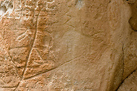 Dry Creek rock art, carved in Fish Canyon tuff, bison figure with zig zag line from shoulder; San  Luis Valley, Rio Grande County, CO