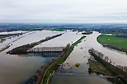 Nederland, Limburg, Gemeente Maasgouw, 15-11-2010; Onder in beeld de overleapt van Linne. Op het tweede plan een oude Maasarm, de enorme meander in de Maas is de Lus van Linne. Roermond aan de horizon..Linne Spillway  with an old branch of river Meuse directly behind it, the lakes on the second plan are the result of the extraction of sand and gravel...luchtfoto (toeslag), aerial photo (additional fee required).copyright foto/photo Siebe Swart