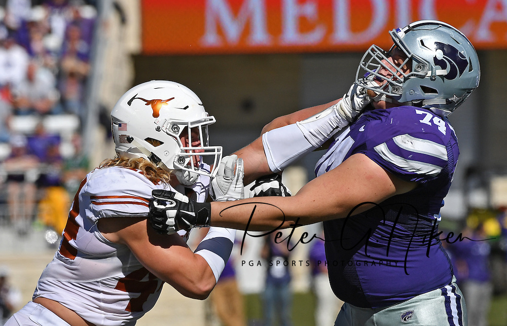 Defensive end Breckyn Hager #44 of the Texas Longhorns battles offensive tackle Scott Frantz #74 of the Kansas State Wildcats on the line during the first half at Bill Snyder Family Stadium in Manhattan, Kansas.
