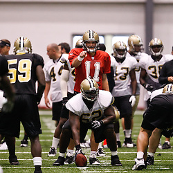 July 31, 2010; Metairie, LA, USA; New Orleans Saints quarterback Patrick Ramsey (11) under center during a training camp practice at the New Orleans Saints indoor practice facility. Mandatory Credit: Derick E. Hingle