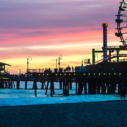 Santa Monica Pier panoramic photo at sunset at Santa Monica Beach. Santa Monica Pier is along the Pacific Ocean in Southern California in he United States. Panorama photo ratio is 1:3. Copyright ⓒ 2017 Paul Velgos with All Rights Reserved.