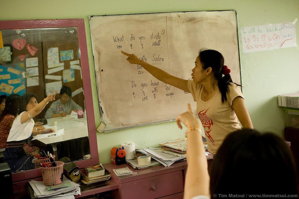 """Studying English at the Chiang Mai office of the Empower Foundation in northern Thailand, which serves as a drop-in center offering computer and informal English training, health education, counseling and other support to sex workers. Founded in 1985 the organization has five centers from Phuket to Mai Sai and advocates for recognition, equality, and basic human rights for sex workers in Thai society where sex work is common, visible, and yet illegal..>>.Empower Chiang Mai opened the """"Can-Do"""" bar which offers fair working conditions to sex workers by complying with all Thai Labor Laws and the recommended occupational health and safety standards..>>.Empower, which works with women over 18 years-old and is a vocal opponent of human trafficking, sexual or labor exploitation of any person,  is also campaigning to change the methods of anti-human trafficking groups. Empower states """"the focus on trafficking in persons has meant many groups with little or no experience on the issues of migration, labor, sex work or women's rights have been created to take advantage of the large sums of money available to support anti-trafficking activities."""".>>.Recommendations by sex workers, many who were Burmese, some who had been trafficked, and all who acknowledged enlisting an agent to migrate illegally into Thailand, stated among other things that """"The primary goal of prosecuting traffickers must be altered to a primary goal of assisting trafficked women and children...if trafficked women and children...are continually rescued and assisted, the use of trafficked women and children will become unprofitable...we are willing to work our illegal status leaves us with no recourse against exploitation by agents or employers...Anti-trafficking groups must work toward improving the human rights situation...Anti-trafficking dialogue and groups have yet to consider us as anti-trafficking workers and human rights defenders...The latest stance from the USA government calling us """"inappropriate pa"""