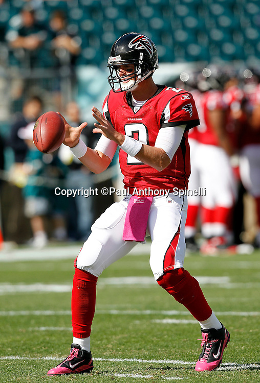Atlanta Falcons quarterback Matt Ryan (2) catches a shotgun snap during pregame warmups at the NFL week 6 football game against the Philadelphia Eagles on Sunday, October 17, 2010 in Philadelphia, Pennsylvania. The Eagles won the game 31-17. (©Paul Anthony Spinelli)