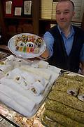 The proprietor offers a spread of delicacies at Hafiz Mustafa,the famous Turkish Delight shop near the Spice Bazaar.