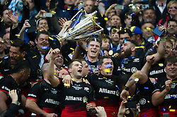 Owen Farrell of Saracens celebrates with the European Rugby Champions Cup trophy - Mandatory byline: Patrick Khachfe/JMP - 07966 386802 - 14/05/2016 - RUGBY UNION - Grand Stade de Lyon - Lyon, France - Saracens v Racing 92 - European Rugby Champions Cup Final.