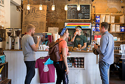LEXINGTON, Ky., -- Magic Beans Coffee Roasters co-owner Allen Warford, left and Zach Joseph try a shot of cold brew while Alex Canada, center, talks with a patron, Saturday, Sept. 30, 2017 at Cup of Commonwealth in LEXINGTON.