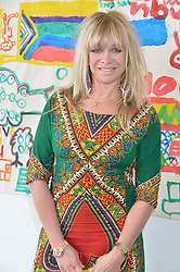 JO WOOD at a lunch in aid of the charity African Solutions to African Problems (ASAP) held at the Louise T Blouin Foundation, 3 Olaf Street, London W11 on 21st May 2014.