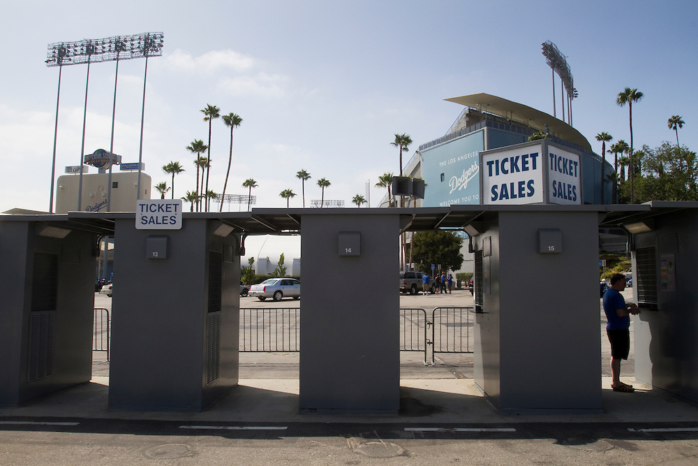 A large decrease in attendance at Dodger games is evident in the lack of ticket sales for a summer game against the league leading Philadelphia Phillies.