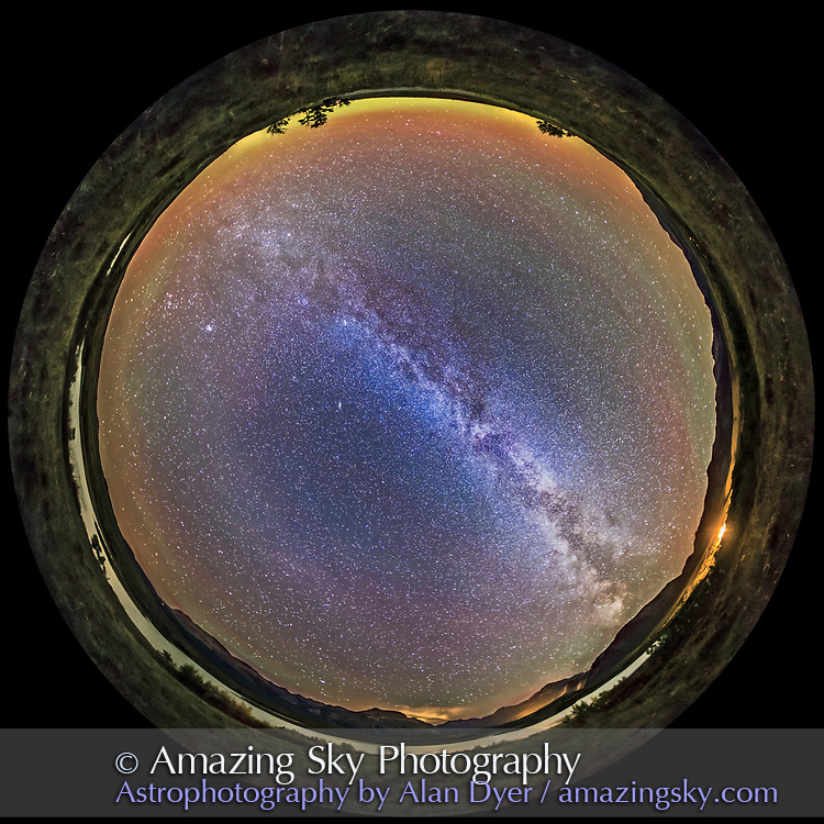 A 360&deg; panorama of the Milky Way and night sky taken at the Maskinonge Lake viewpoint in Waterton Lakes National Park, Alberta, Canada. I shot this Sept 21, 2014 on a very clear night with a faint aurora appearing to the north (top) and some airglow to the east and west. The ground is lit solely by starlight. The lights are from the Park entrance gates. The Big Dipper is at top (north). Taurus and the Pleiades are rising at left (east). Sagittarius is setting at lower right (southwest). The faint glow of Gegenschein is visible to the southeast at lower left.<br /> <br /> This is a stitch of 8 segments, each shot with the 15mm full-frame fisheye lens, for 1 minute at f/2.8 and with the Canon 6D at ISO 5000. I used PTGui to stitch the segments, with this version being a spherical fish-eye projection.