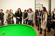 INDIA WATERS; KATE TOMLINSON; CRISPIN SOMERVILLE; LILY COLE;  PLAYING Gabriel Orozco's 'Carambole with a Pendulum?  (an oval-shaped billiard table with no pockets ), Gabriel Orozco reception, Tate Modern, London. 18 January 2010. .-DO NOT ARCHIVE-© Copyright Photograph by Dafydd Jones. 248 Clapham Rd. London SW9 0PZ. Tel 0207 820 0771. www.dafjones.com.