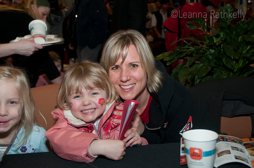 Amy Buchanan and her daughter Gaby enjoy the crafts, fun, music and culture at the Pancake Breakfast at Canada House in Whistler during the 2010 Olympic Winter Games.