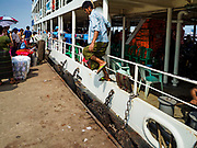 20 NOVEMBER 2017 - YANGON, MYANMAR: A passenger jumps off the Dala Ferry as it docks in Dala. Tens of thousands of commuters ride the ferry every day. It brings workers into Yangon from Dala, a working class community across the river from Yangon. A bridge is being built across the river, downstream from the ferry to make it easier for commuters to get into the city.     PHOTO BY JACK KURTZ