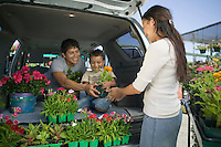 Family Loading Plants into Minivan