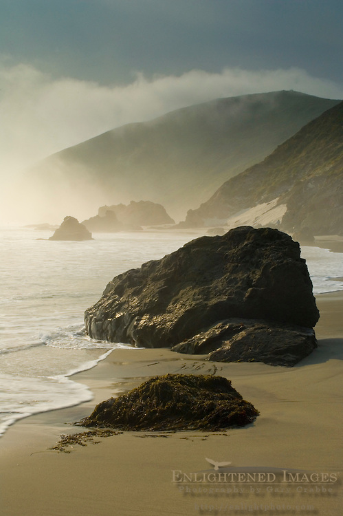 Fog shrouded hills and cliffs at sunset along Pfeiffer Beach, Big Sur Coast, Monterey County, California