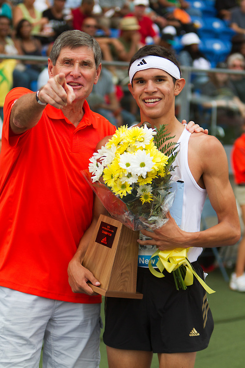 Boys Dream Mile winner Montoya with legend miler Jim Ryun