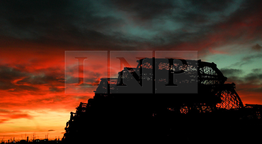 © Licensed to London News Pictures. <br /> 30/11/2016. <br /> REDCAR, UK.  <br /> A striking sunset looks down over lobster pots in the Paddy's Hole area of South Gare on the last day of Autumn.<br /> Photo credit: Ian Forsyth/LNP