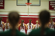 The Teams listen to the National Anthem before the start of the girls basketball game between the Rice Green Knights and the Champlain Valley Union Redhawks at CVU High School on Monday night December 14, 2015 in Hinesburg. (BRIAN JENKINS/for the FREE PRESS)
