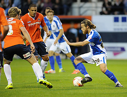 Stuart Sinclair of Bristol Rovers takes on Cameron McGeehan of Luton Town and Nathan Doyle of Luton Town - Mandatory byline: Neil Brookman/JMP - 07966386802 - 18/08/2015 - FOOTBALL - Kenilworth Road -Luton,England - Luton Town v Bristol Rovers - Sky Bet League Two