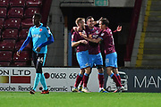 Scunthorpe United forward Lee Novak (17) celebrates scoring with Scunthorpe United midfielder Josh Morris (11) and Scunthorpe United forward Paddy Madden (9) goal to go 1-0 during the EFL Sky Bet League 1 match between Scunthorpe United and Fleetwood Town at Glanford Park, Scunthorpe, England on 17 October 2017. Photo by Ian Lyall.