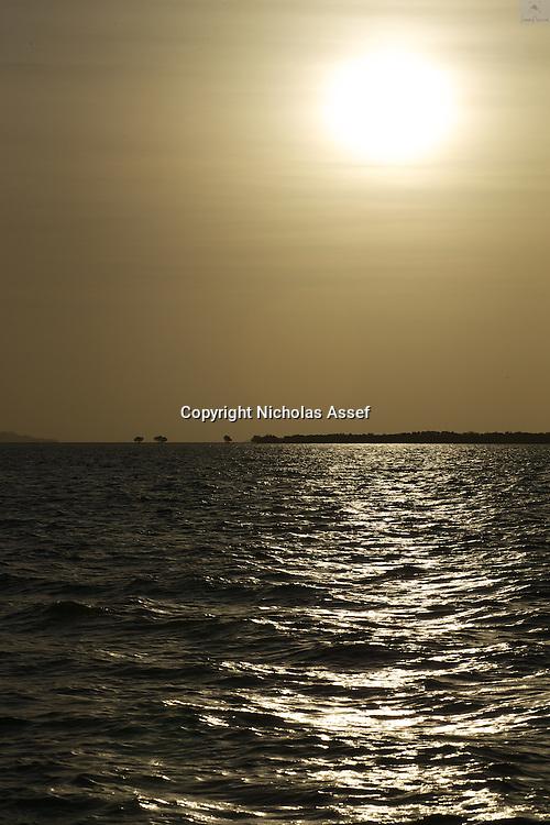 Reflections of Gold off sea chop in summer Fijian waters