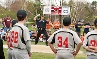 Laconia Police Chief Chris Adams throws out the first pitch for Laconia Little League's opening day ceremonies held at Colby Field Saturday morning.  (Karen Bobotas/for the Laconia Daily Sun)