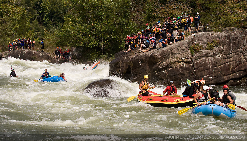 Kayakers watch unidentified whitewater kayakers and rafters navigate through the rapids at Pillow Rock on the Gauley River during American Whitewater's Gauley Fest weekend. The upper Gauley, located in the Gauley River National Recreation Area is considered one of premier whitewater rivers in the country.