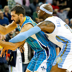 October 29, 2010; New Orleans, LA, USA; Denver Nuggets power forward Al Harrington (7) fouls New Orleans Hornets small forward Peja Stojakovic (16) of Serbia during the fourth quarter at the New Orleans Arena. The Hornets defeated the Nuggets 101-95.  Mandatory Credit: Derick E. Hingle