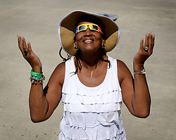 Ayana Moreland of Charlotte, N.C. basks in the solar eclipse from the rooftop of the Discovery Place parking deck on Monday, Aug. 21, 2017 in Charlotte, N.C. Photo by Jeff Siner/Charlotte Observer/TNS/ABACAPRESS.COM