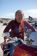 Portrait of the korean man sitting on his Harley Davidson motorbike in harbour / Jukbeon, South Korea, Republic of Korea, KOR, 05 October 2009.