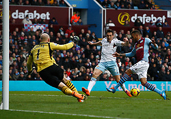 Aston Villa's Ryan Bertrand clears just in time from West Ham United's Stewart Downing - Photo mandatory by-line: Matt Bunn/JMP - Tel: Mobile: 07966 386802 08/02/2014 - SPORT - FOOTBALL - Birmingham - Villa Park - Aston Villa v West Ham United - Barclays Premier League