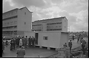 Caravan Dwellings..1963..03.10.1963..10.03.1963..3rd October 1963..Because families were being evacuated from potentially dangerous buildings in Dublin City , temporary mobile home accomodation was provided. The residents would live in the homes until the new blocks of flats were ready to accomodate them. These images were taken at Donnybrook, Dublin...Image shows members of Dublin Corporation inspecting one of the caravans which would be used to temporarily house the evacuated families. The caravans were supplied by Shannon Caravans.