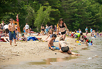 Beachgoers flock to Ellacoya State Park for the some fun in the sun on Friday.  Karen Bobotas for the Laconia Daily Sun.