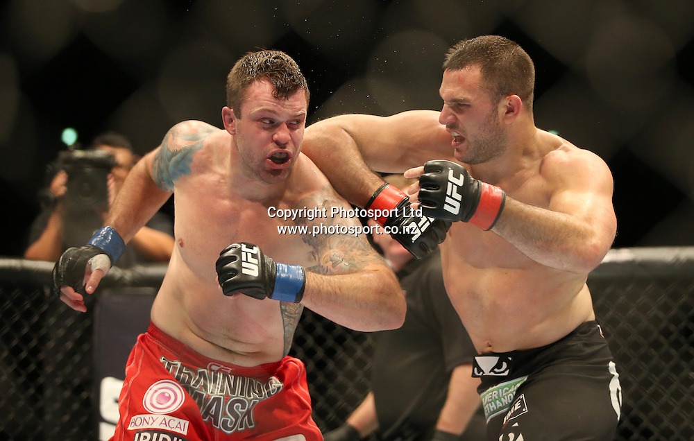Gian Villante, right, battles with Sean O'Connell during the UFC Ultimate Fighting Championship fight night held at Vector Arena in Auckland on Saturday 28th of July 2014. <br /> Credit; Peter Meecham/ www.photosport.co.nz