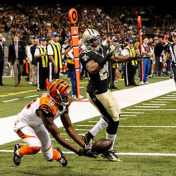 Nov 16, 2014; New Orleans, LA, USA; Cincinnati Bengals wide receiver A.J. Green (18) is unable to come up with a catch in the endzone as New Orleans Saints cornerback Corey White (24) defends during the second quarter of a game at the Mercedes-Benz Superdome. Mandatory Credit: Derick E. Hingle-USA TODAY Sports