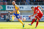 Dean Cox of Leyton Orient and Alan McCormack of Brentford during the Sky Bet League 1 match at the Matchroom Stadium, London<br /> Picture by Mark D Fuller/Focus Images Ltd +44 7774 216216<br /> 15/03/2014