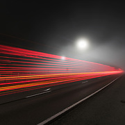 Truck Lights illuminate I-79 outside of Clendenin on a foggy morning in West Virginia.