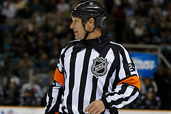 March 31, 2011; San Jose, CA, USA;  NHL referee Stephen Walkom (24) before a face off between the San Jose Sharks and the Dallas Stars during the first period at HP Pavilion.  San Jose defeated Dallas 6-0. Mandatory Credit: Jason O. Watson / US PRESSWIRE