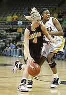 25 JANUARY 2007: Minnesota guard Emily Fox (4) tries to get around Iowa forward Jenee Graham (24) in Iowa's 80-78 overtime loss to Minnesota at Carver-Hawkeye Arena in Iowa City, Iowa on January 25, 2007.