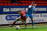 Chris Solly of Charlton Athletic is fouled by  Dale Jennings of Barnsley during the Sky Bet Championship match at The Valley, London<br /> Picture by David Horn/Focus Images Ltd +44 7545 970036<br /> 15/04/2014