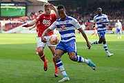 Reading midfielder Jordan Obita (11) attempts to clear the ball with Nottingham Forest forward Jamie Ward (19) closing in during the EFL Sky Bet Championship match between Nottingham Forest and Reading at the City Ground, Nottingham, England on 22 April 2017. Photo by Jon Hobley.