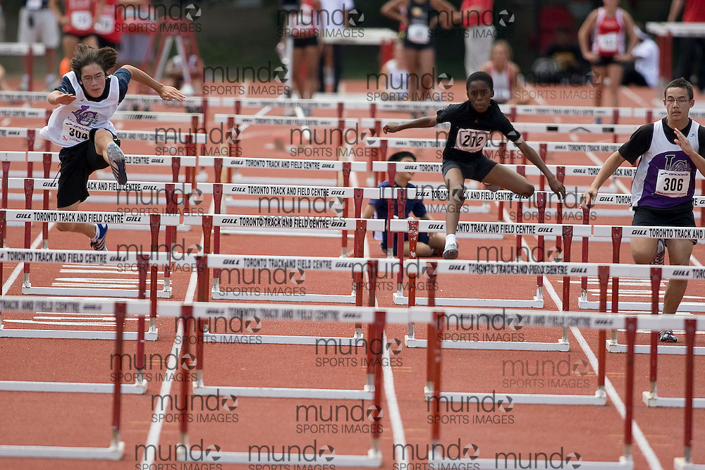 (Toronto, Ontario---3 August 2008)  Jordan Sherwood (304), \m212\ (212), and  Aaron Stemmler (306)\ competing in the bantam boys 80m hurdles final at the 2008 OTFA Supermeet II, the Bantam, Midget, Youth Track and Field Championships. This image is copyright Sean W. Burges, and the photographer can be contacted at www.msievents.com.