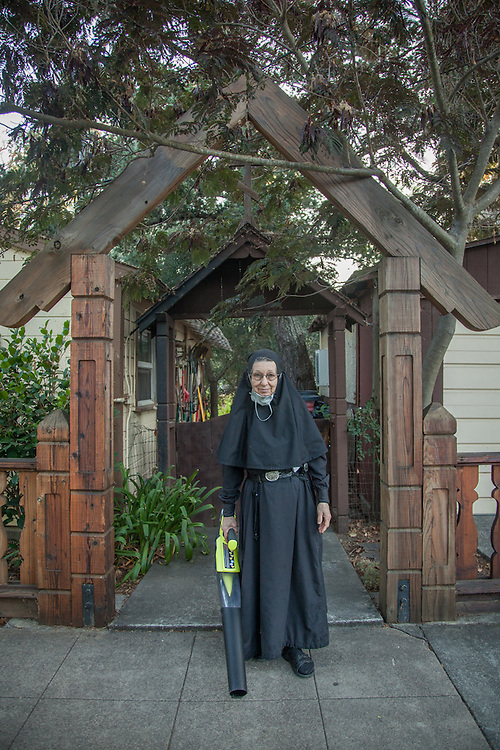 Sister Pearl prepares to clear leaves in front of her home at the Holy Assumption Monastery on Washington Street in Calistoga.